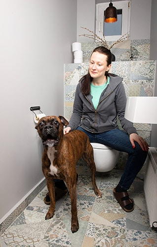 dog and woman on toilet